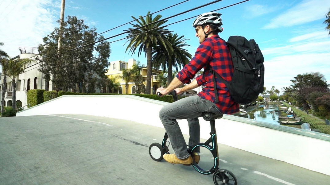 man riding the smacircle s1 on the road